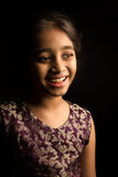 Little Indian girl in traditional dress, isolated on black background Stock Image