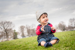 Little Infant boy. Happy Little infant boy sitting a park Royalty Free Stock Image