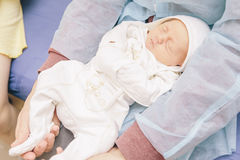 Little infant newborn child in maternity hospital on his fathers Royalty Free Stock Photography