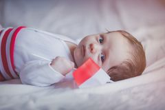 Little infant with Poland flag lying down. On white background Royalty Free Stock Photography