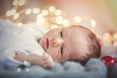 Little Infant With Christmas Baubles Around Royalty Free Stock Images