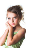 A little innocent girl in green dress royalty free stock image