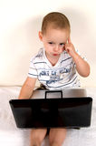 Little intelligent child. In thinking pose Royalty Free Stock Photos
