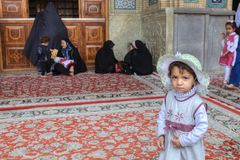 Little Iranian girl near women in black Muslim clothes, Shiraz. Stock Photography