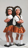 Little Irish Dancers. Cute little girls irish dancers in costume smiling standing Stock Photography
