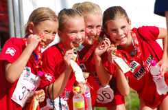 Little Ironkids athletes with medals Royalty Free Stock Image