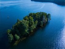 Little island in the center of lake, Russia stock photos