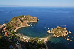 The little island Isola Bella in Giardini Naxos, as seen from Ta royalty free stock photos