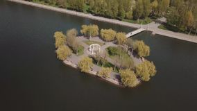 Little island in the lake view from the drone stock video footage