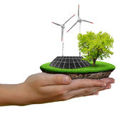 Little island with solar panel and wind turbines Stock Photos