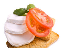 Little italian lunch. Toast with cheese and tomatoes with basil on a white background Stock Photo