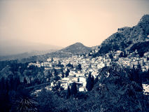 Little Italian town of Taormina at the foot of Mount Etna in black and white; dramatic retro style Stock Images