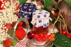 Little jam jars with fruits Royalty Free Stock Photo