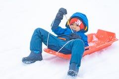 Japanese boy is sliding down the snow sled in Gala Yuzawa Ski resort royalty free stock photos