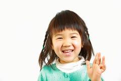 Little Japanese girl smiles Stock Images