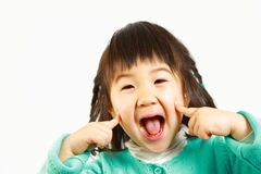Little Japanese girl smiles Royalty Free Stock Photography