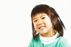 Little Japanese girl smiles Stock Image