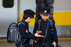 Little Japanese Student waited for a train to school. TOKYO, JAPAN - NOVEMBER 22: Japanese Student in Tokyo, Japan on November 22, 2013. Unidentified little Stock Images