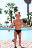 Little joy boy swims in the sea. Swim in the pool. Hot sunny summer day, the beach Royalty Free Stock Images