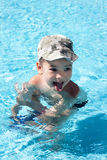 Little joy boy swims in the sea Royalty Free Stock Photos