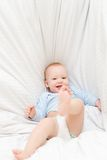 Little joyful baby fall on bed Royalty Free Stock Photo