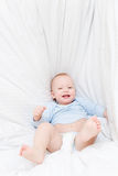 Little joyful baby fall on bed Royalty Free Stock Photography