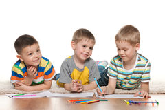 Little joyful boys draw on paper Stock Photos