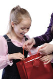 Little joyful girl receiving gift Stock Photos