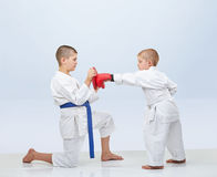 Little karateka beats punch on the simulator that brother keeps Stock Photography