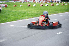 Little karting racer on the track Royalty Free Stock Photo