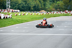 Little karting racer on the track Stock Photos