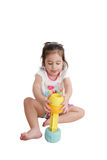 Little kgir playing with toys Stock Images