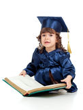 Little kid in academician clothes with book Royalty Free Stock Photos
