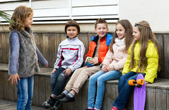 Little kid acting out phrase to friends. Happy little kid acting out phrase to friends during charade outdoor Stock Photography
