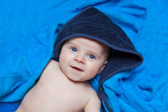 Little kid baby boy against blue bath towel Royalty Free Stock Images