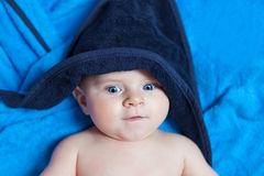 Little kid baby boy against blue bath towel Stock Photo