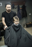 Little kid in barbershop Stock Photography