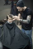 Little kid in barbershop Stock Photo