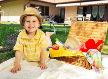 Little kid and the basket full of toys Royalty Free Stock Photos