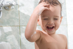 Little kid is bathing Stock Photo