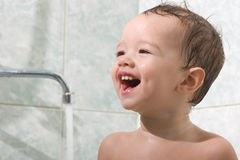 Little kid is bathing Royalty Free Stock Photos
