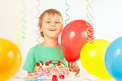 Little kid with a birthday cake on white background Royalty Free Stock Photo