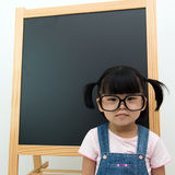 Little kid with blackboard Royalty Free Stock Photography
