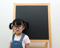 Little kid with blackboard Stock Image