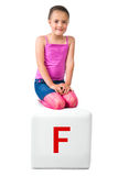 Little kid on the block with letter Stock Photography
