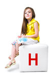 Little kid on the block with letter Stock Photos