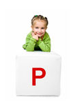 Little kid on the block with letter Royalty Free Stock Photo
