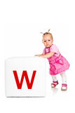 Little kid on the block with letter Stock Images