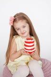 Little kid blonde girl holding a red velvet cake Royalty Free Stock Photography