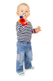 Little kid blows in the football beep Stock Photography